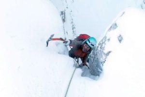 Girl climbing on snow
