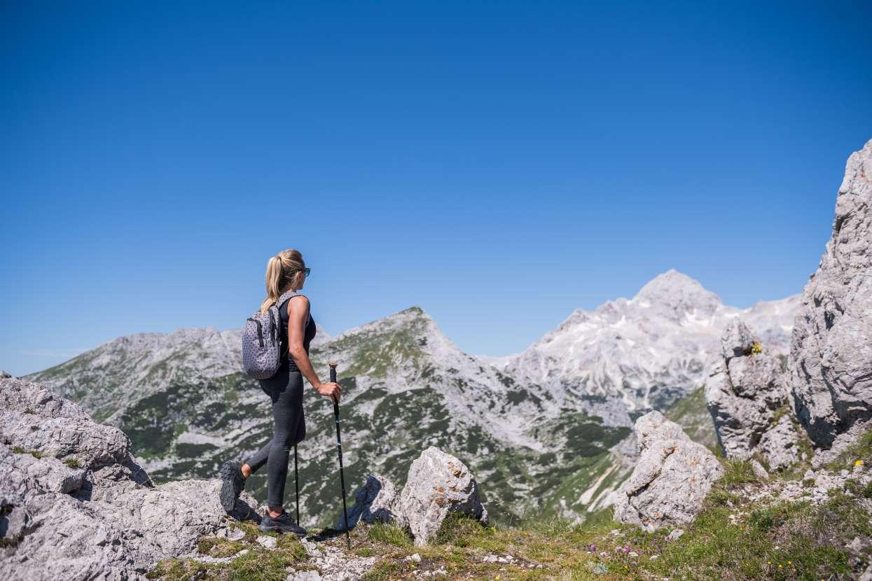 Hiker watching Triglav from Viševnik