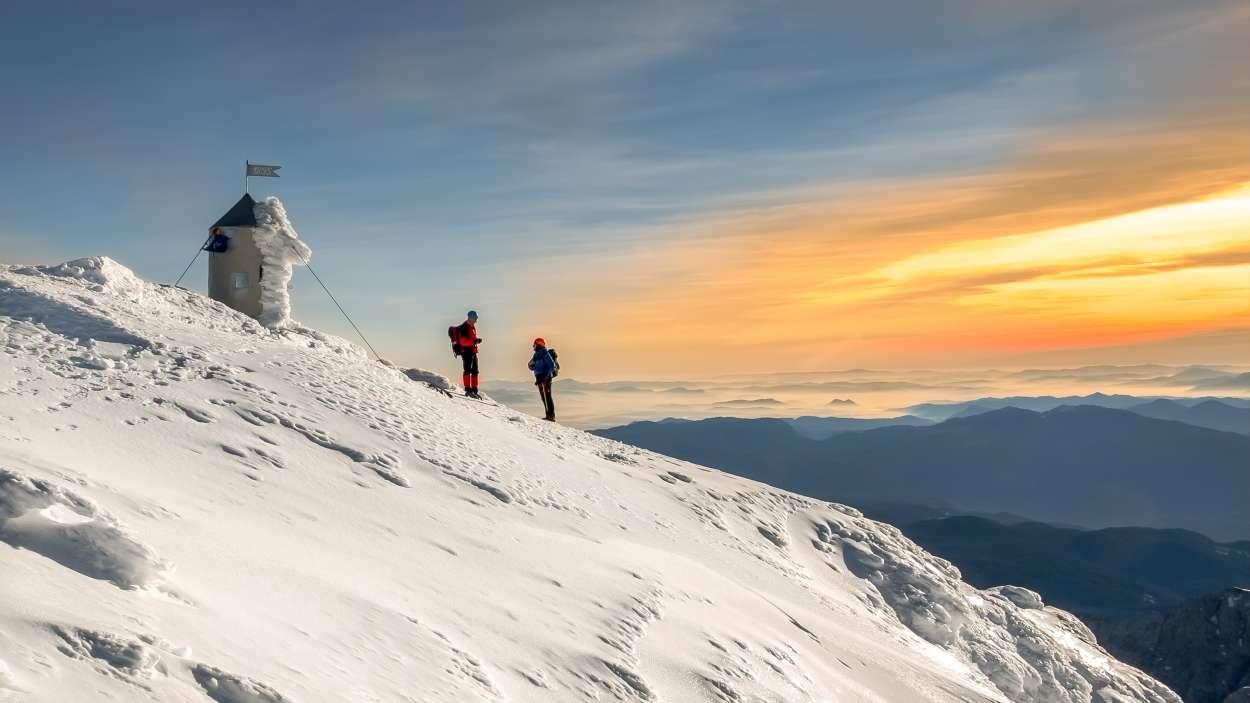 Sunrise on top of Triglav in winter