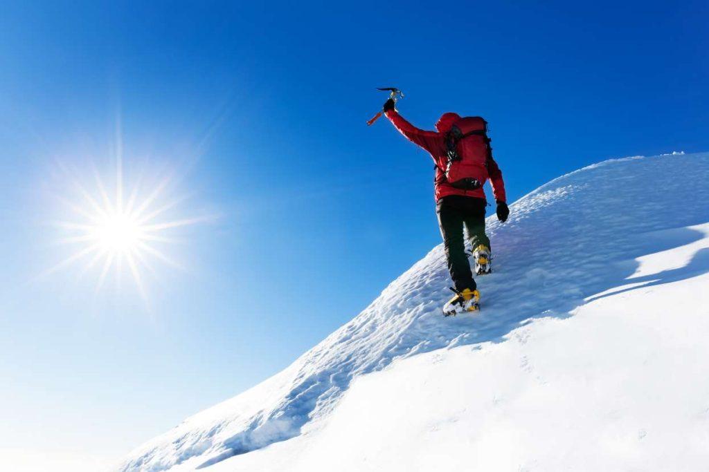 climbing on snowy summit